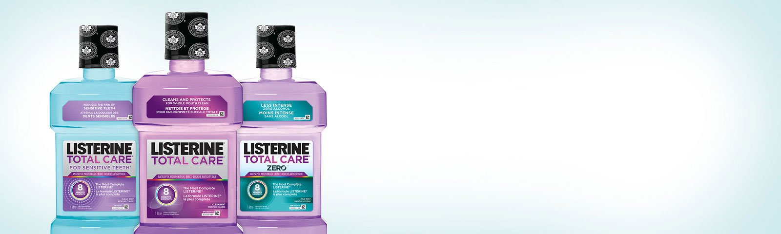 Three Listerine mouthwash bottles